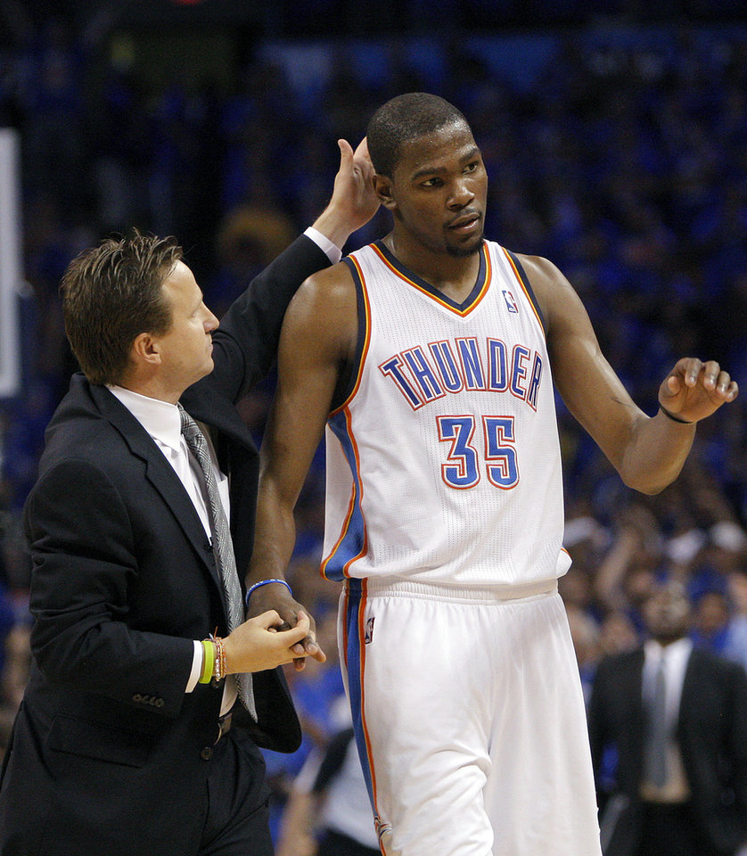 Photo - Oklahoma City head coach Scott Brooks congratulates Oklahoma City's Kevin Durant (35) during Game 5 in the second round of the NBA playoffs between the Oklahoma City Thunder and the L.A. Lakers at Chesapeake Energy Arena in Oklahoma City, Monday, May 21, 2012. Photo by Sarah Phipps, The Oklahoman