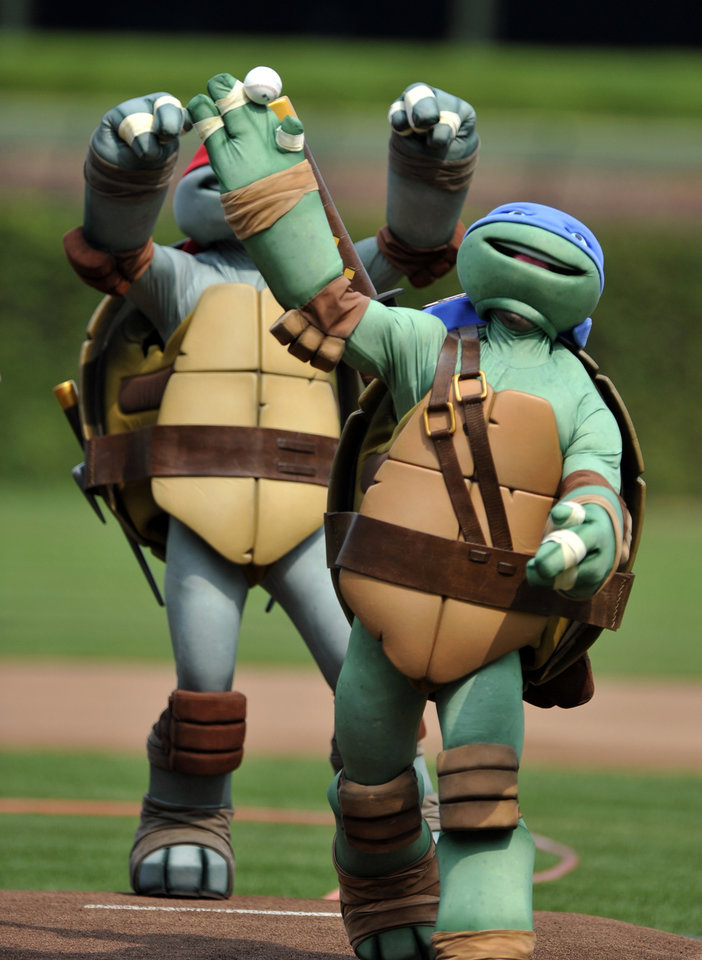 Photo -   An a actor dressed as a Teenage Mutant Ninja Turtle throws out the ceremonial first pitch at Wrigley Field before a baseball game between the Pittsburgh Pirates and Chicago Cubs in Chicago, Sunday, Sept. 16, 2012. (AP Photo/Paul Beaty)