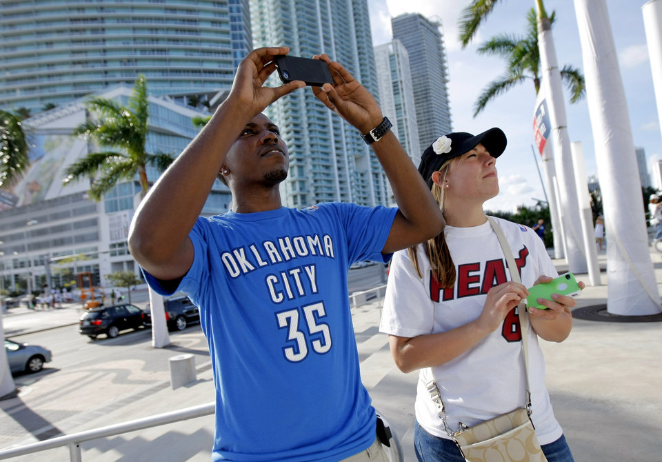 Photo - Steve Jones, and Tiffany Wentzel from Ohio take a photo outside the arena before Game 3 of the NBA Finals between the Oklahoma City Thunder and the Miami Heat at American Airlines Arena, Sunday, June 17, 2012. A former Lebron James fan, Jones now roots against James for the Thunder.  Photo by Bryan Terry, The Oklahoman