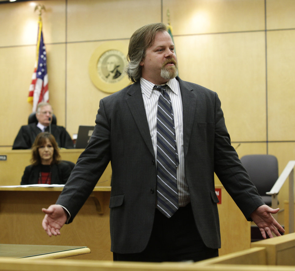 Photo -   Travis Currie, a defense attorney for Steve Powell, gives his closing argument during Powell's voyeurism trial, Tuesday, May 15, 2012, in Tacoma, Wash. Powell is the father-in-law of missing Utah mother Susan Powell. (AP Photo/Ted S. Warren)