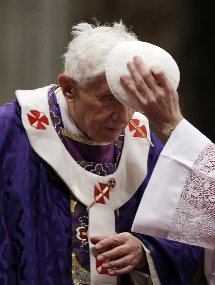 """Bishop Guido Marini holds Pope Benedict XVI's skull cap during the Ash Wednesday mass in St. Peter's Basilica at the Vatican, Wednesday, Feb. 13, 2013.  Ash Wednesday marks the beginning of Lent, a solemn period of 40 days of prayer and self-denial leading up to Easter. Pope Benedict XVI told thousands of faithful Wednesday that he was resigning for """"the good of the church"""", an extraordinary scene of a pope explaining himself to his flock that unfolded in his first appearance since dropping the bombshell announcement. (AP Photo/Gregorio Borgia)"""