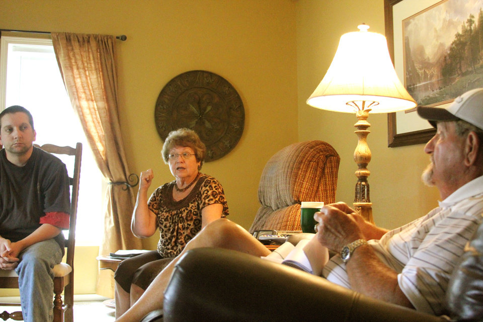 Chad Hatfield and his parents Bob and Karen sit in the living room of their new home. The Hatfields previous residence was bought out by the government after the town they lived in was included in the Tar Creek superfund project