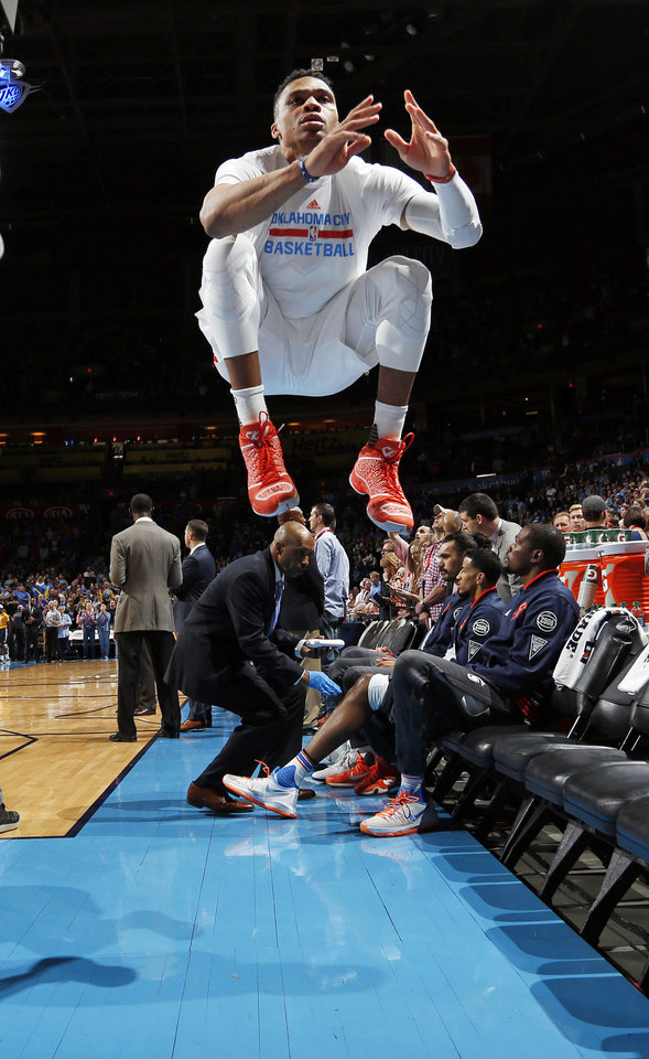 Photo - Oklahoma City's Russell Westbrook (0) leaps during his pre-game ritual before an NBA basketball game between the Oklahoma City Thunder and the Portland Trailblazers at the Chesapeake Energy Arena in Oklahoma City, Monday, March 14, 2016. Oklahoma City won 128-94. Photo by Nate Billings, The Oklahoman