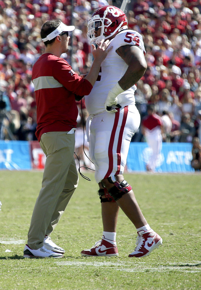 Record - Oklahoma head coach Lincoln Riley talks with Marquis Hayes (Fifty four) within the fourth quarter at some point soon of the Crimson River Showdown college football sport between the University of Oklahoma Sooners (OU) and the Texas Longhorns (UT) at Cotton Bowl Stadium in Dallas, Saturday, Oct. 12, 2019. OU gained 34-27. [Sarah Phipps/The Oklahoman]