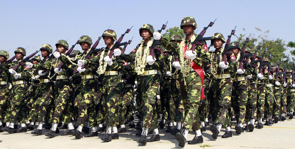 In this photo taken on March. 27, 2012, Myanmar soldiers march during a ceremony to mark the country's 67th Armed Forces Day in Naypyitaw, Myanmar. Ethnic Kachin rebels in Myanmar say clashes in the country�s north are continuing despite a government promise to cease fire. An official with the Kachin Independence Army says government forces stopped attacks Saturday, Jan. 19, 2013 around an army base at Lajayang, just south of the rebel-held town of Laiza. But the official says army assaults are under way elsewhere on least three other rebel positions in the region. (AP Photo/Khin Maung Win)