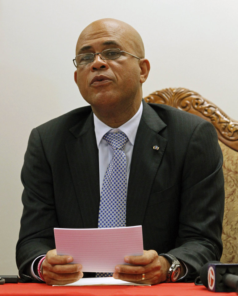 Photo - President Michel Martelly talks to reporters during a news conference, Monday, Dec, 10, 2012, in North Miami Beach, Fla. Martelly met with members of the Haitian-American community during his visit to South Florida. Haiti's government has been pitching business and tourism opportunities in the Caribbean country to Haitians living abroad, along with international investors. (AP Photo/Alan Diaz)