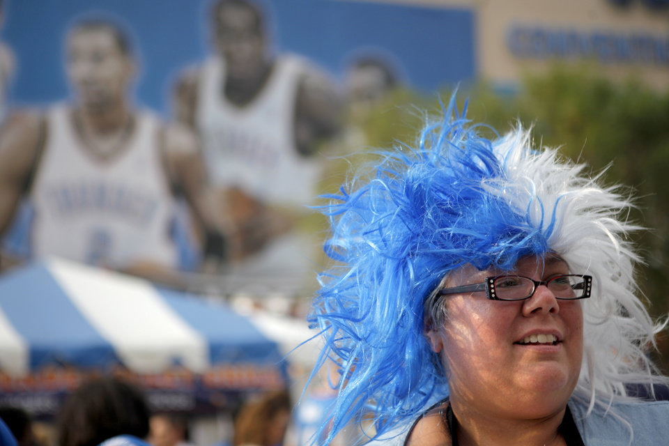 Photo - Mitzi Carter of Oklahoma City waits to get her face painted before game 4 of the Western Conference Finals in the NBA basketball playoffs between the Dallas Mavericks and the Oklahoma City Thunder at the Oklahoma City Arena in downtown Oklahoma City, Monday, May 23, 2011. Photo by Bryan Terry, The Oklahoman