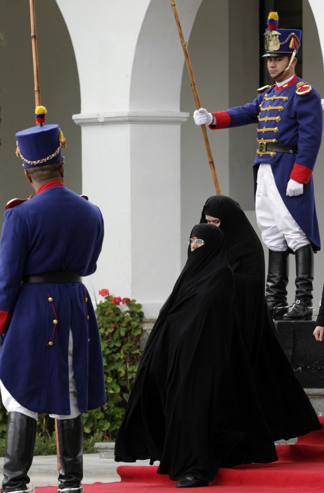 Photo - Iran's first lady Azam al-Sadat Farahi, front, arrives to an air base as she prepares to depart Quito, Ecuador, Friday Jan. 13, 2012. Azam al-Sadat Farahi accompanied her husband, Iran's President Mahmoud Ahmadinejad, during a four nation tour in Latin America.  (AP Photo/Dolores Ochoa) ORG XMIT: DOR105