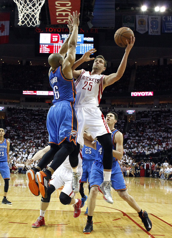 Photo - Houston's Chandler Parsons (25) shoots a lay up as Oklahoma City's Derek Fisher (6) defends during Game 3 in the first round of the NBA playoffs between the Oklahoma City Thunder and the Houston Rockets at the Toyota Center in Houston, Texas, Sat., April 27, 2013. Photo by Bryan Terry, The Oklahoman