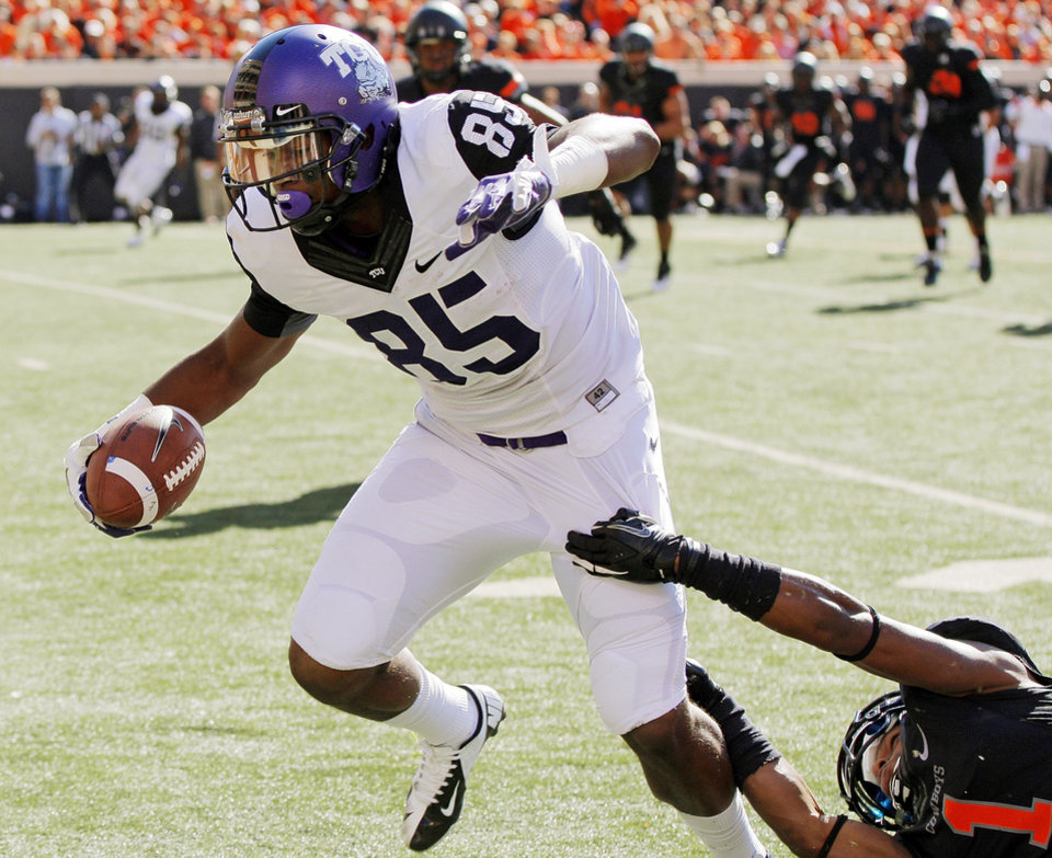 TCU's LaDarius Brown (85) breaks away from Oklahoma State's Kevin Peterson (1) on his way to a touchdown in the first quarter during a college football game between Oklahoma State University (OSU) and Texas Christian University (TCU) at Boone Pickens Stadium in Stillwater, Okla., Saturday, Oct. 27, 2012. Photo by Nate Billings, The Oklahoman
