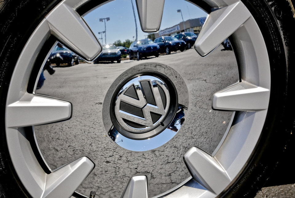 Photo - Cars are reflected in a hubcap at the new Bob Howard Volkswagen dealership in Edmond.PHOTO BY CHRIS LANDSBERGER, THE OKLAHOMAN  CHRIS LANDSBERGER - CHRIS LANDSBERGER