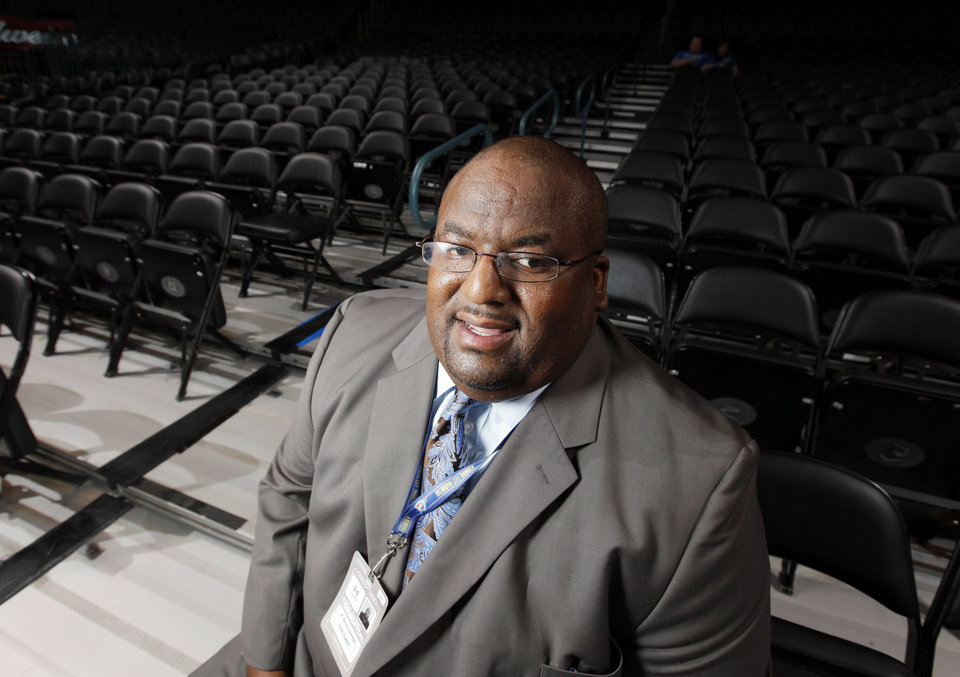 Photo - The Rev. A. Byron Coleman III, Thunder team chaplain, waits for the start of an NBA basketball game between the Memphis Grizzlies and the Oklahoma City Thunder at Chesapeake Energy Arena in Oklahoma City.  Photo by Nate Billings, The Oklahoman