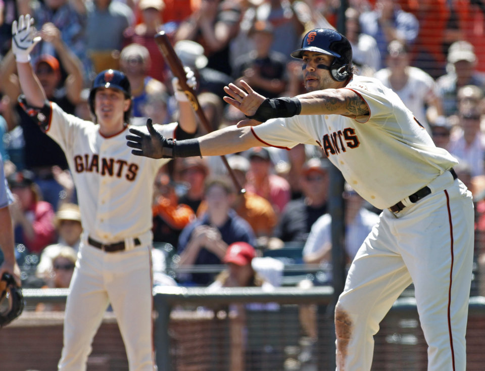 Photo - San Francisco Giants'  Michael Morse, right, and Tim Lincecum react while watching Andrew Susac score against the Philadelphia Phillies during the second inning of a baseball game, Sunday, Aug. 17, 2014 in San Francisco. (AP Photo/George Nikitin)