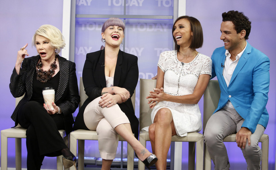 Photo - This Sept. 5, 2013 photo shows co-hosts, from left, Joan Rivers, Kelly Osbourne, Giuliana Rancic and George Kotsiopoulos from the E! series