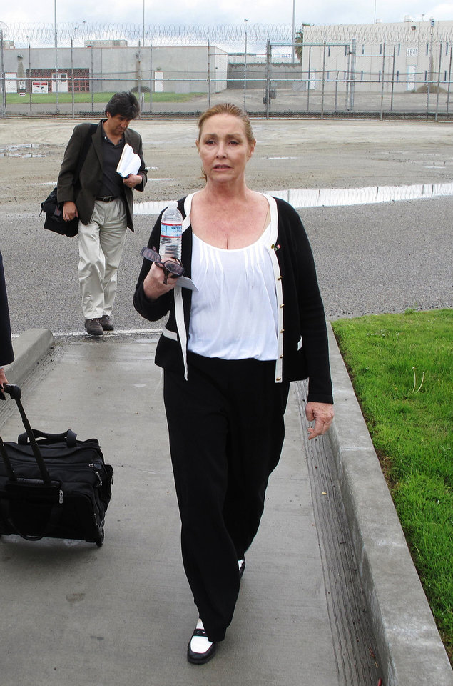 Photo -   In this Wednesday, April 11, 2012 photo, Debra Tate, younger sister of murdered actress Sharon Tate, leaves Corcoran State Prison in Corcoran, Calif., after she testified at a parole hearing for Charles Manson. The panel denied parole for mass murderer Manson, 77, in his 12th and possibly final bid for freedom. Tate and Barbara Hoyt, the Manson family member whose testimony helped put the killers in prison, have bonded in their long quest to keep those responsible for the murders behind bars. (AP Photo/Tracie Cone)