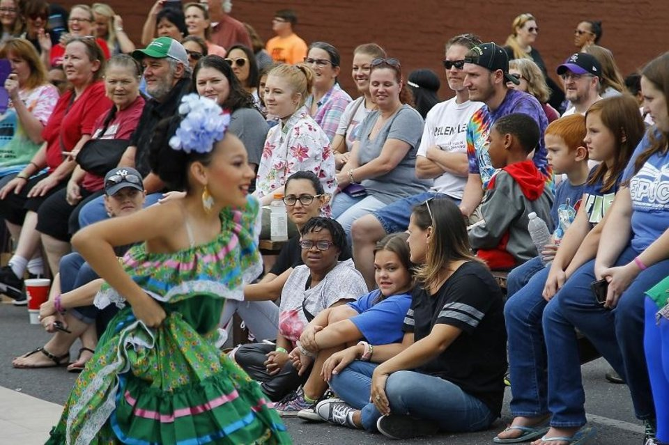Photo - A crowd watches dancers from Everything Goes Dance Studio perform during the Plaza District Festival in Oklahoma City, Saturday, Sept. 30, 2017. [Bryan Terry/The Oklahoman Archives]