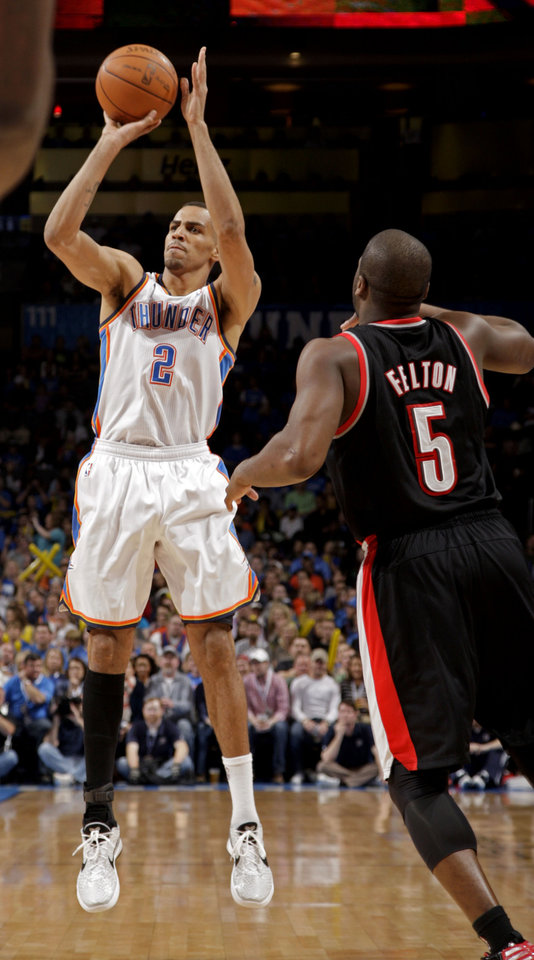 Oklahoma City's Thabo Sefolosha (2) shoots in front of Portland 's Raymond Felton (5) during the NBA basketball game between the Oklahoma City Thunder and the Portland Trailblazers at Chesapeake Energy Arena in Oklahoma City, Sunday, March 18, 2012. Photo by Sarah Phipps, The Oklahoman.