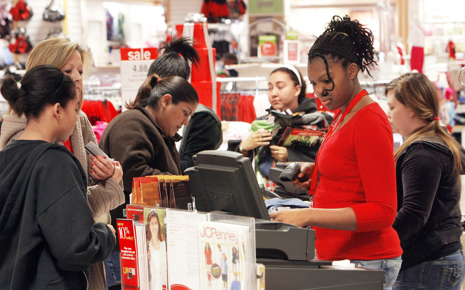 Photo - A line of shoppers check out Friday at J.C. Penney in Penn Square Mall. The store opened at 4 a.m. Photo By David McDaniel, The Oklahoman