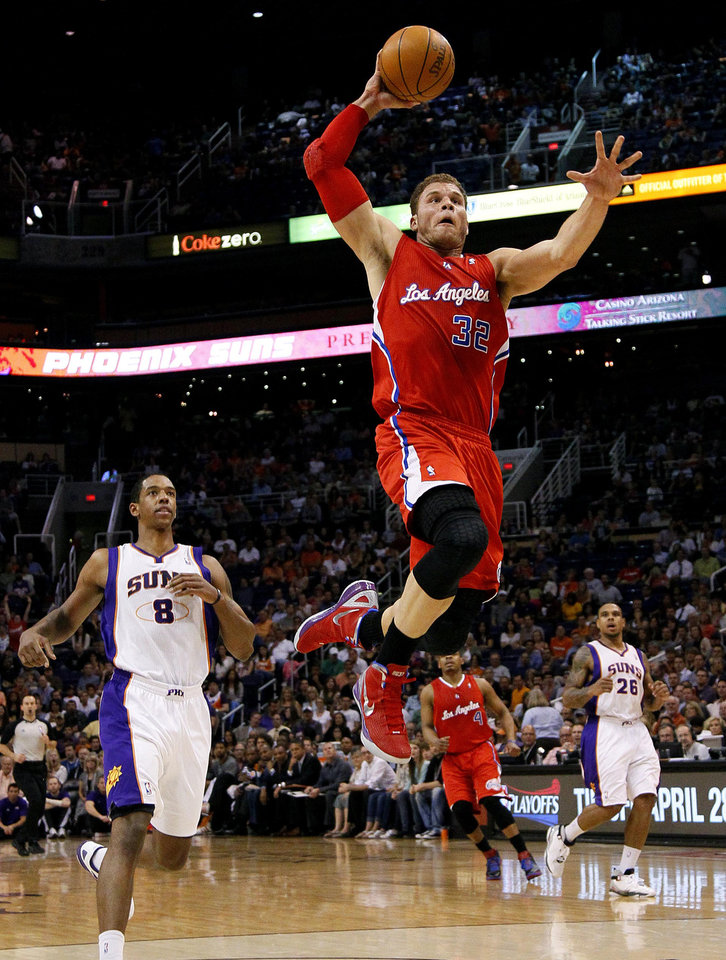 Photo -   Los Angeles Clippers' Blake Griffin (32) drives past Phoenix Suns' Channing Frye (8) during the first half of an NBA basketball game, Thursday, April 19, 2012, in Phoenix. (AP Photo/Matt York)