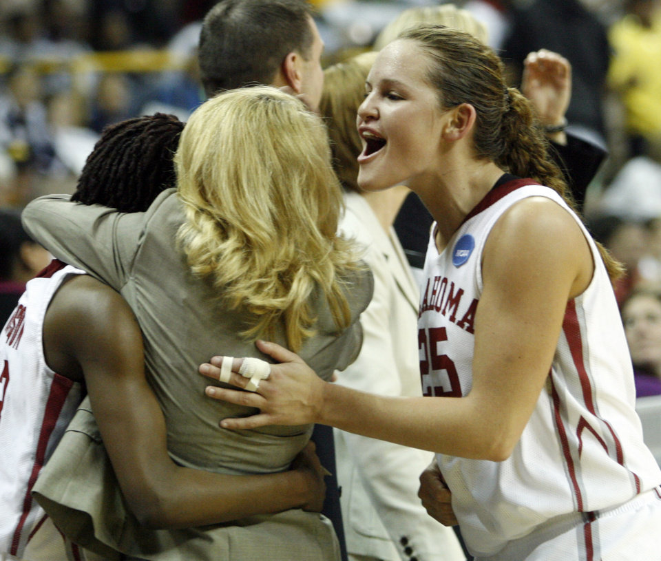 Head coach Sherri Coale hugs Danielle Robinson as Whitney Hand smiles as the University of Oklahoma (OU) defeats Georgia Tech 69-50 in round two of the 2009 NCAA Division I Women\'s Basketball Tournament at Carver-Hawkeye Arena at the University of Iowa in Iowa City, IA on Tuesday, March 24, 2009. PHOTO BY STEVE SISNEY, THE OKLAHOMA