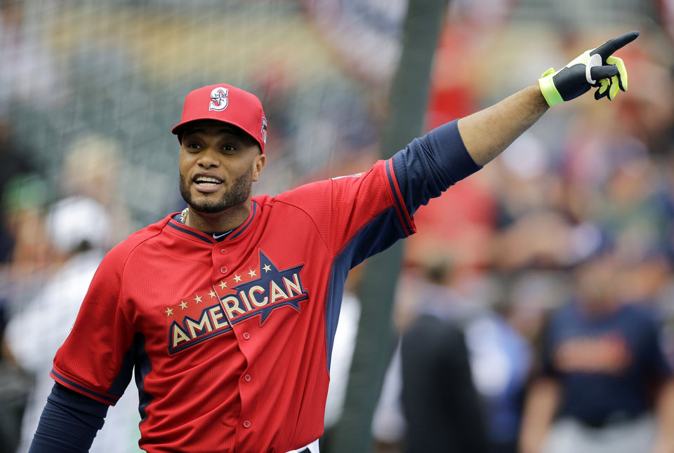 Photo - American League second baseman Robinson Cano, of the Seattle Mariners, reacts during batting practice for the MLB All-Star baseball game, Monday, July 14, 2014, in Minneapolis. (AP Photo/Jeff Roberson)