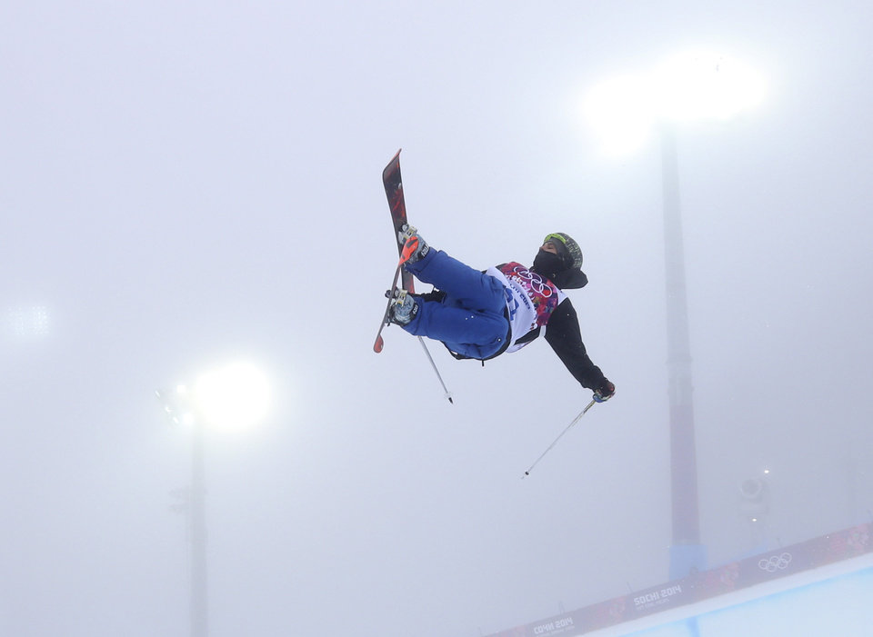 Photo - Switzerland's Joel Gisler jumps during a freestyle skiing training session in the halfpipe at the Rosa Khutor Extreme Park, at the 2014 Winter Olympics, Monday, Feb. 17, 2014, in Krasnaya Polyana, Russia. (AP Photo/Sergei Grits)