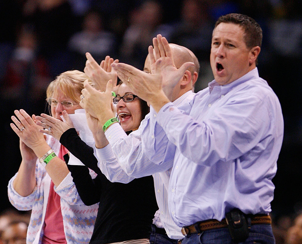 Photo - Fans react to a tie score late in the second half as the Oklahoma City Thunder plays the Houston Rockets at the Ford Center in Oklahoma City, Okla. on Friday, January 9, 2009. 