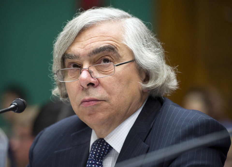 Photo - FILE - In this Sept. 18, 2013 file photo, Energy Secretary Ernest Moniz testifies on Capitol Hill in Washington. The Energy Department is poised to approve $6.5 billion in lending for two nuclear reactors under construction in Georgia. Energy Secretary Ernest Moniz is expected to announce the deal at a speech in Washington on Wednesday, a day before he visits the $14 billion Vogtle nuclear plant being built by Southern Co. and several partners about 30 miles southeast of Augusta. (AP Photo/Cliff Owen, File)