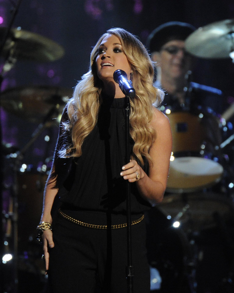 Photo - Carrie Underwood speaks at the 2014 Rock and Roll Hall of Fame Induction Ceremony on Thursday, April, 10, 2014 in New York. (Photo by Charles Sykes/Invision/AP)