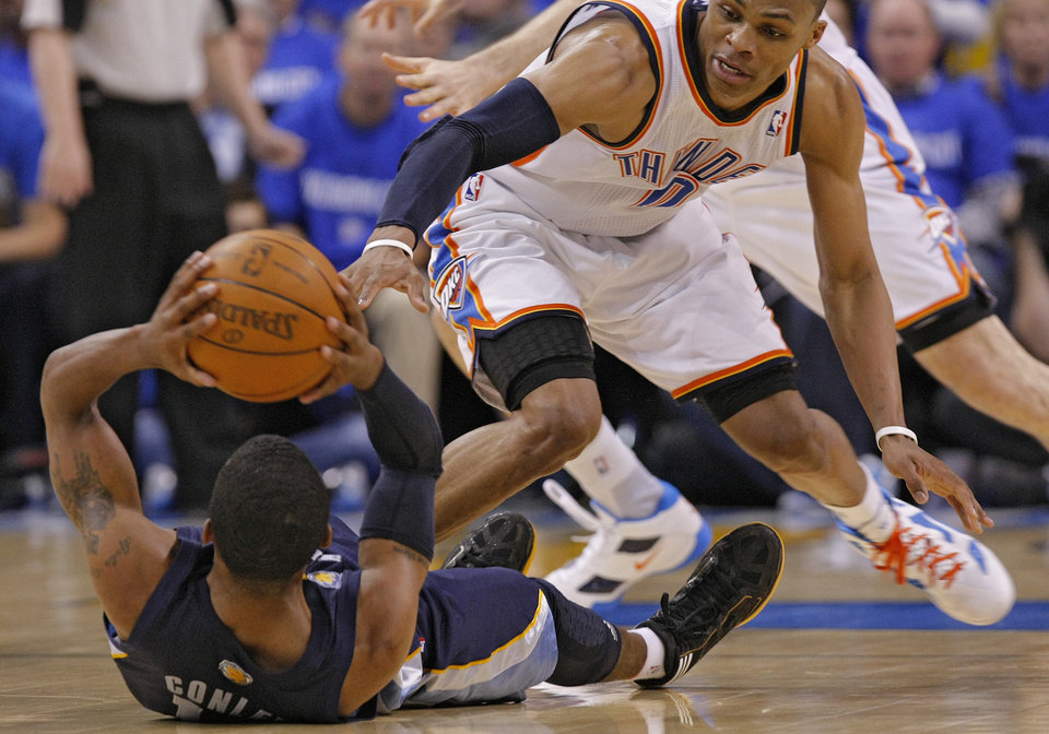 Photo - Oklahoma City' Russell Westbrook (0) goes after a loose ball against Memphis' Mike Conley (11) during game one of the Western Conference semifinals between the Memphis Grizzlies and the Oklahoma City Thunder in the NBA basketball playoffs at Oklahoma City Arena in Oklahoma City, Sunday, May 1, 2011. Photo by Chris Landsberger, The Oklahoman