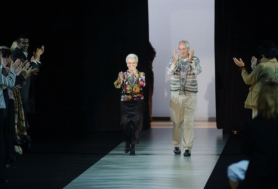 Photo - FILE - In this Oct. 2003 file photo Rosita, left, and Ottavio Missoni take the catwalk after presenting their Spring/Summer 2004 fashion collection, in Milan, Italy. Italian fashion company Missoni says its co-founder, Ottavio Missoni, has died in his home earlier on Thursday, May 9, 2013 in northern Italy. Missoni, who was 92, founded the iconic fashion brand of zigzagged-patterned knitwear along with his wife, Rosita, in 1953. The Missonis are a family fashion dynasty, with the couple's children and their offspring involved in expanding the brand. (AP Photo/Antonio Calanni, File)
