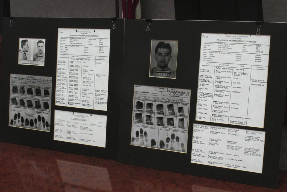"This photo from Tuesday, Dec. 18, 2012, shows a display of prison records for Richard Hickock, left, and Perry Smith, used at a news conference in Lansing, Kan. The two men were executed for the 1959 multiple murders that inspired Truman Capote's book, ""In Cold Blood,"" and their remains have been exhumed and reburied so that authorities could collect DNA samples as possible evidence linking them to Florida killings. (AP Photo/John Hanna)"