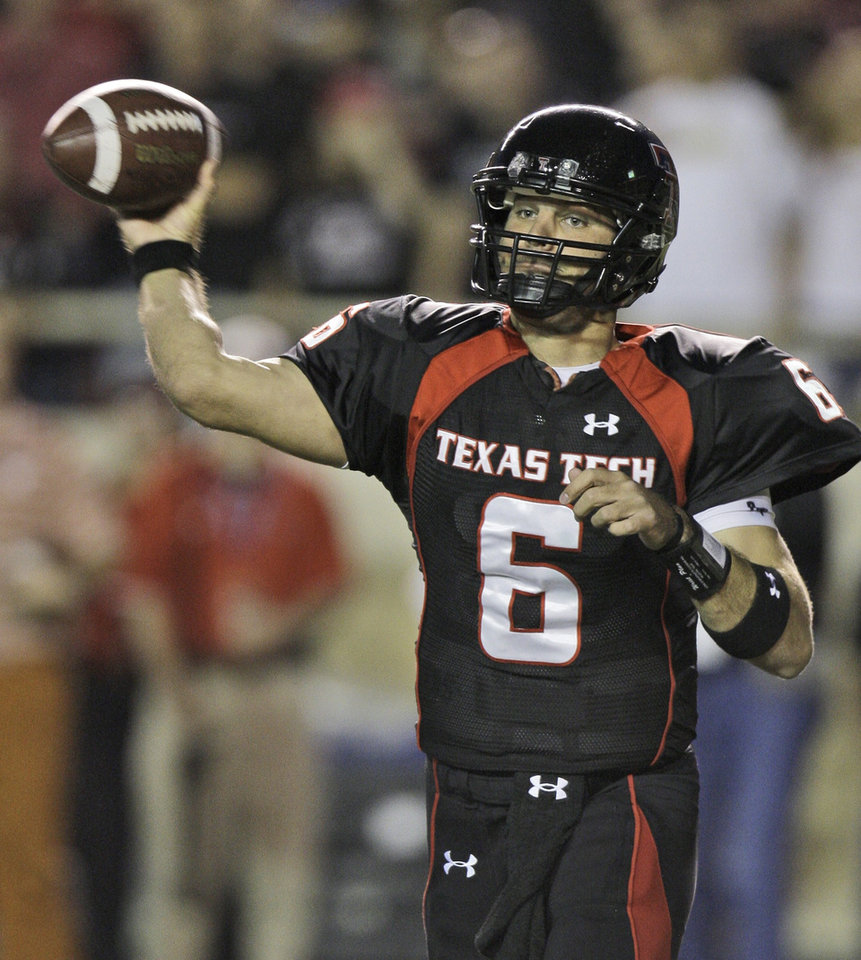 Photo - Texas Tech University quarterback Graham Harrell passes during the first half of an NCAA college football game against Texas in  Lubbock, Texas, Saturday, Nov. 1, 2008. (AP Photo/LM Otero)  ORG XMIT: TXMO105