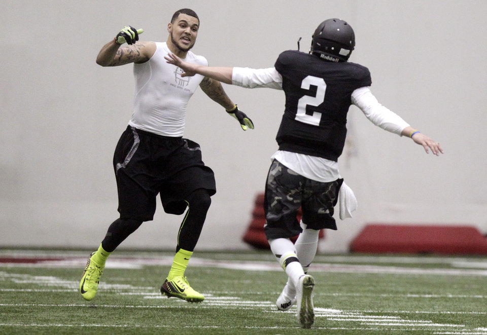 Photo - Texas A&M quarterback Johnny Manziel (2) and wide receiver Mike Evans celebrate after a pass reception during a drill at pro day for NFL football representativesin College Station, Texas, Thursday, March 27, 2014. (AP Photo/Patric Schneider)
