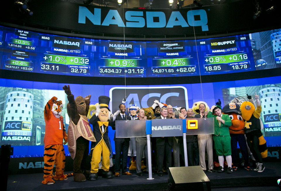 Photo - Atlantic Coast Conference mascots join ACC and NASDAQ officials for the ringing of the closing bell  on Monday, July 1, 2013 in New York.  The Atlantic Coast Conference officials and coaches visited the NASDAQ Market Site in Times Square to officially announce the addition of its three new members in Notre Dame, Pitt and Syracuse. (AP Photo/Bebeto Matthews)
