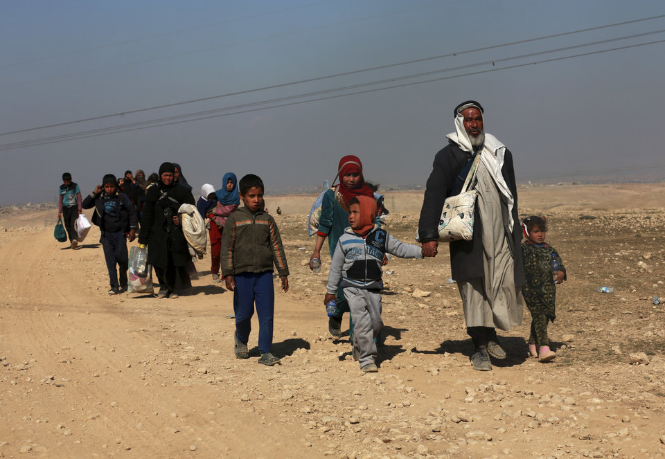 Photo - Displaced Iraqis flee their homes due to fighting between Iraqi special forces and Islamic State militants, on the western side of Mosul, Iraq, Thursday, Feb. 2017. The Iraqi security forces advance comes as part of a major assault that started five days earlier to drive Islamic State militants from the western half of Mosul, Iraq's second-largest city. (AP Photo/ Khalid Mohammed)