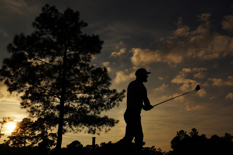 Photo -  Dustin Johnson watches his shot on the 18th hole during the third round of the Masters golf tournament on Saturday in Augusta, Ga. [AP Photo/Matt Slocum]