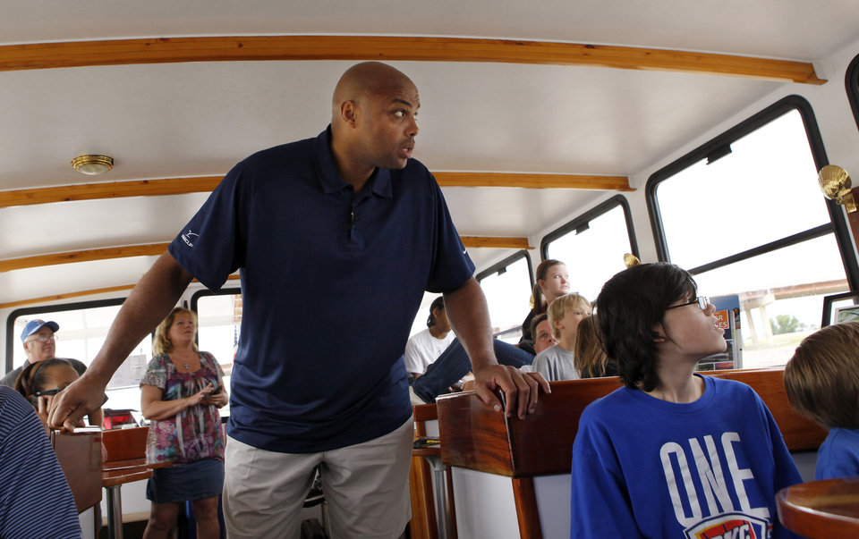 Photo - Charles Barkley looks out the window of a Devon river cruiser while taking an Oklahoma River Cruise in Oklahoma City, Friday, June 1, 2012. Barkley took the cruise on the Oklahoma River as part of a tour of Oklahoma City. Photo by Nate Billings, The Oklahoman