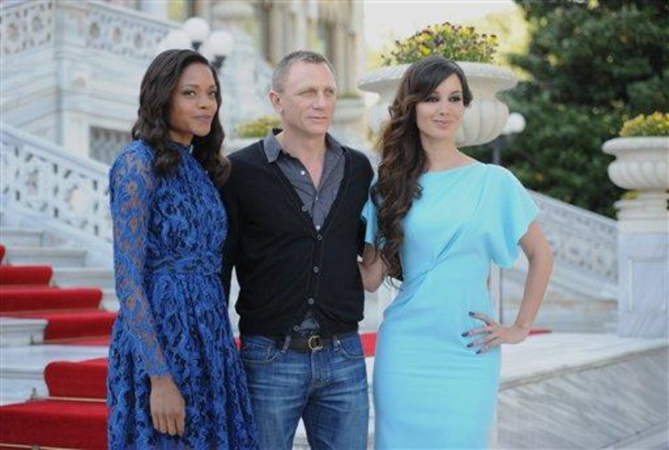 Photo - French actress Berenice Marlohe, right, British actor Daniel Craig and British actress Naomie Harris arrive  for the photocall of the 23rd film in the James Bond series, 'Skyfall', in Istanbul, Turkey, Sunday, April 29, 2012.(AP Photo )