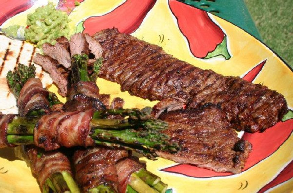 Fajitas and bacon-wrapped asparagus are great on the grill and sure to please at your tailgate. - THE OKLAHOMAN
