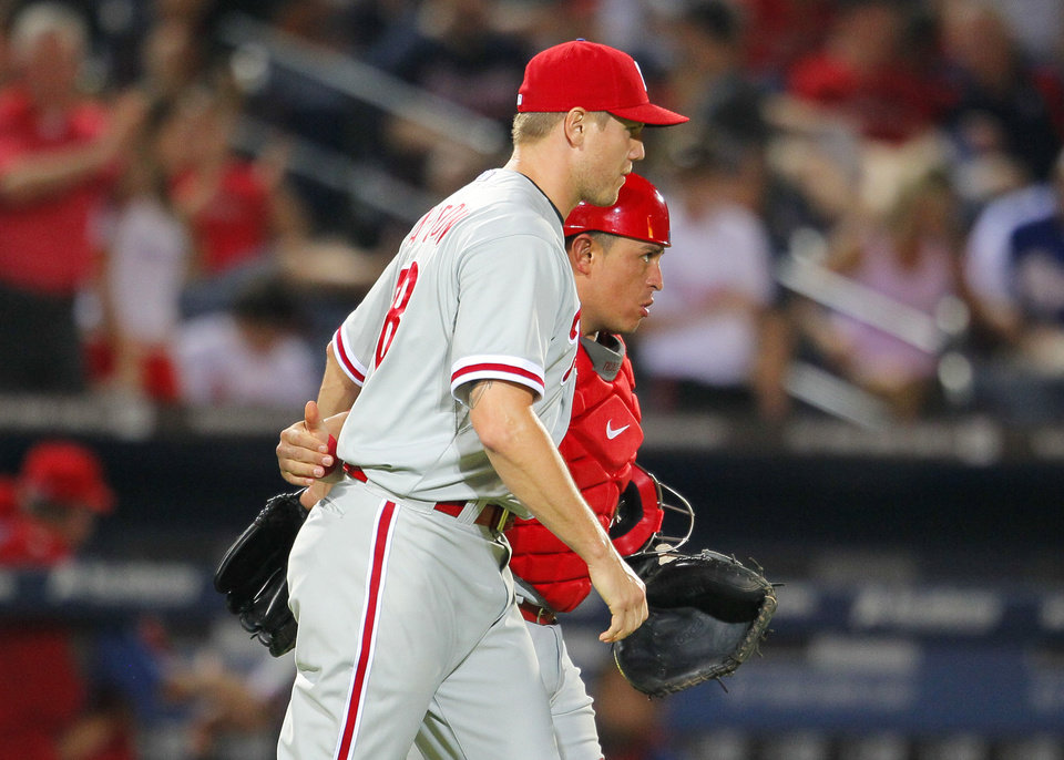 Photo - Philadelphia Phillies relief pitcher Jonathan Papelbon (58) celebrates the win with catcher Carlos Ruiz (51) in a baseball game against the Atlanta Braves Tuesday, June 17, 2014, in Atlanta. (AP Photo/Todd Kirkland)