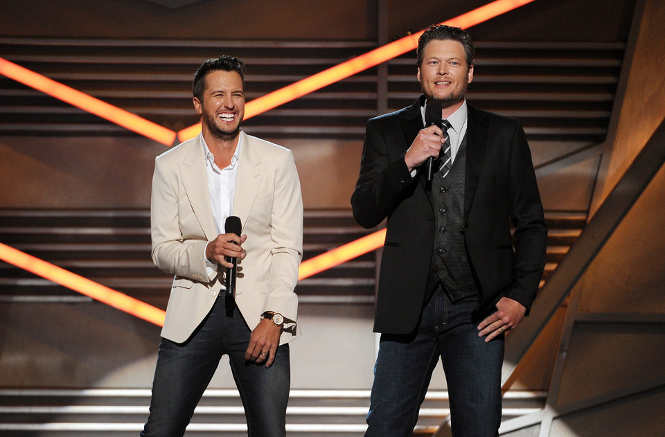 Photo - Hosts Luke Bryan, left, and Blake Shelton speak on stage at the 49th annual Academy of Country Music Awards at the MGM Grand Garden Arena on Sunday, April 6, 2014, in Las Vegas. (Photo by Chris Pizzello/Invision/AP)