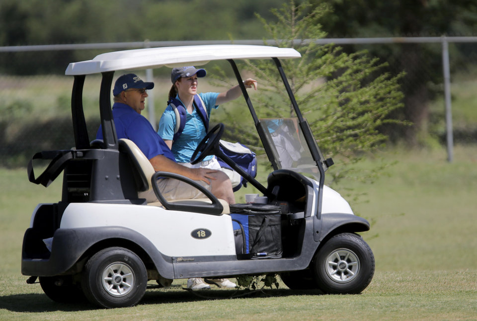 Photo - Andi McGill of Turner talks to a man about her fairway shot after it missed the green during the 2014 Class 2A girls' golf state championship tournament  Wednesday, May 7, 2014, at Trosper Golf Course in Del City.  Photo by Jim Beckel, The Oklahoman