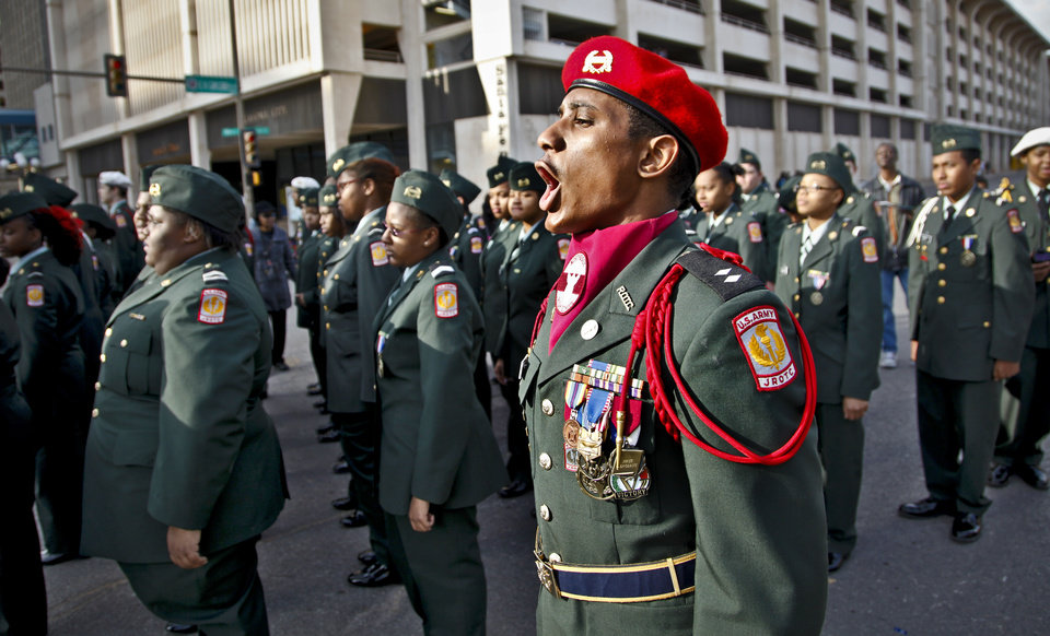 Photo - The Northeast High School junior ROTC marches during the Martin Luther King Jr. parade in downtown on Monday, Jan. 17, 2011, in Oklahoma City, Okla. .  