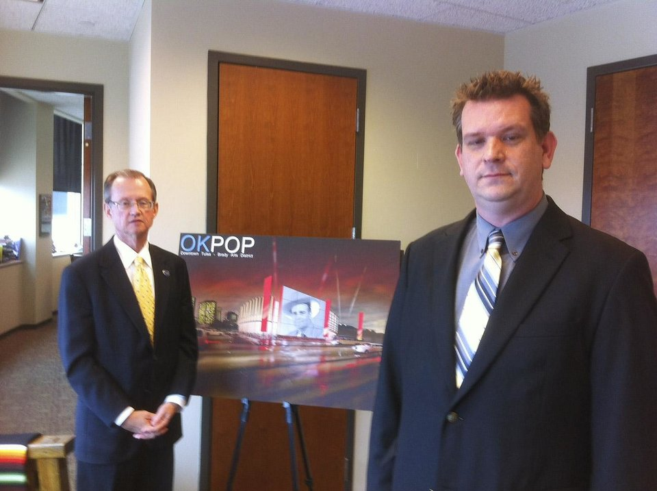 Bob Blackburn, left, Oklahoma Historical Society director and Jeff Moore, projects director for the proposed Oklahoma Museum, right, stand next to an artist\'s rending of a proposed Oklahoma Museum of Popular Culture Wednesday, March 7. Photo by Robert Medley, The Oklahoman