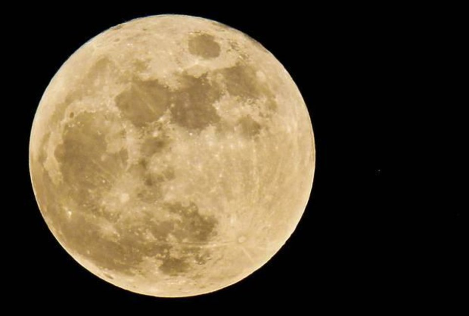 Photo - The full moon is a tint of orange as it hangs in the sky over Oklahoma on May 27, 2010, in Oklahoma City. Photo by Chris Landsberger, The Oklahoman