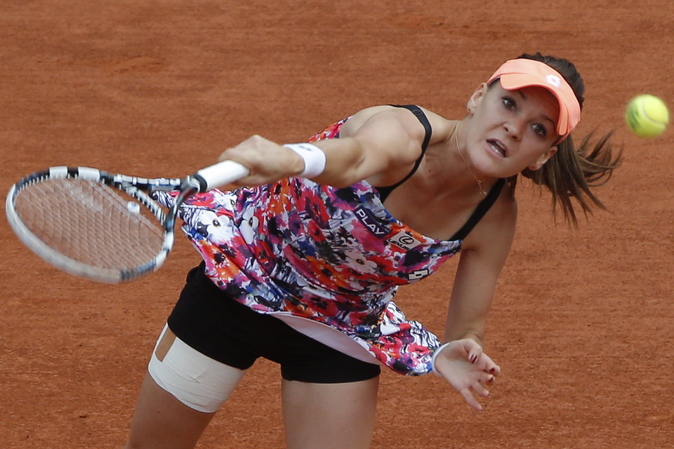 Photo - Poland's Agnieszka Radwanska serves the ball during the third round match of the French Open tennis tournament against Croatia's Ajla Tomljanovic at the Roland Garros stadium, in Paris, France, Friday, May 30, 2014.  (AP Photo/Michel Euler)
