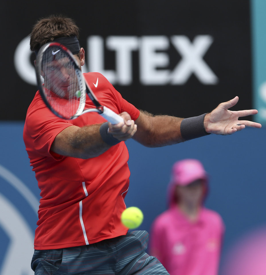 Photo - Juan Martin del Potro of Argentina plays a shot in his quarterfinals match against Radek Stepanek of the Czech Republic during the Sydney International tennis tournament in Sydney, Australia, Thursday, Jan. 9, 2014. (AP Photo/Rob Griffith)