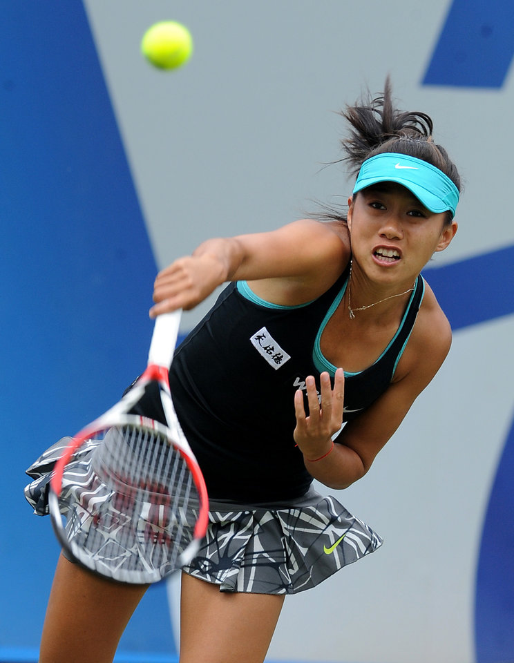 Photo - China's Shuai Zhang in action against Serbia's Ana Ivanovic during their semifinal match at the Aegon Classic tennis tournament at Edgbaston Priory Club, Birmingham, England, Saturday June 14, 2014. (AP Photo/PA, Rui Vieira) UNITED KINGDOM OUT  NO SALES  NO ARCHIVE
