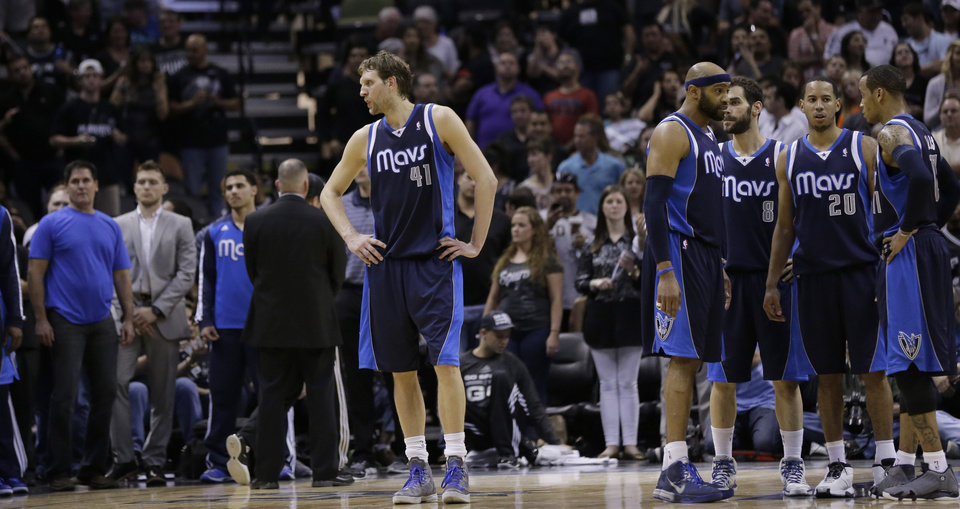Photo - Dallas Mavericks' Dirk Nowitzki (41), of Germany,  stands alone during a timeout  as the team waits for play to resume during the second half of Game 5 of the opening-round NBA basketball playoff series against the San Antonio Spurs, Wednesday, April 30, 2014, in San Antonio. San Antonio won 109-103. (AP Photo/Eric Gay)